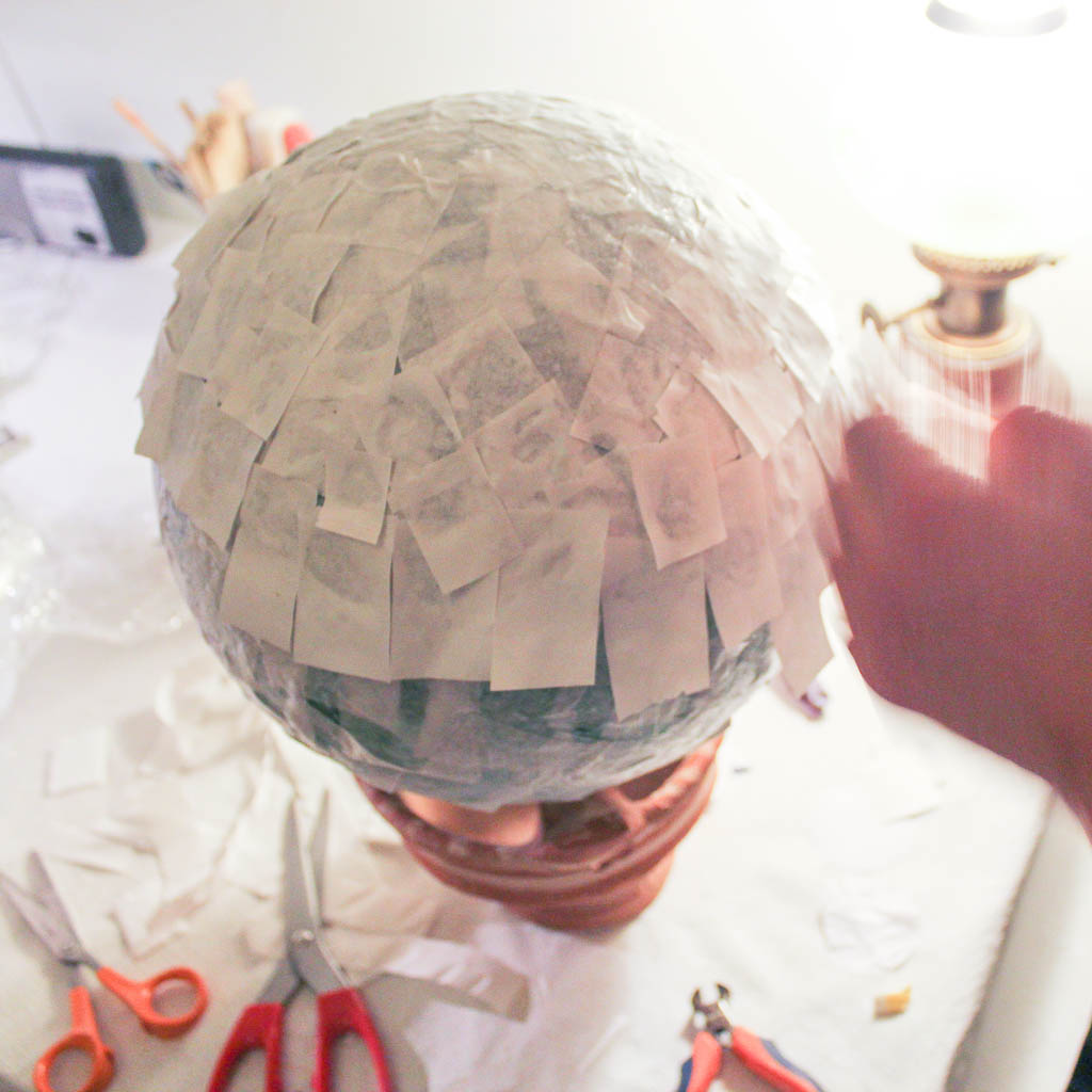 Gluing paper on balloons...